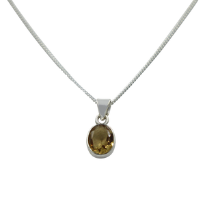 Cute oval faceted Citrine pendant set on a deep bezel setting