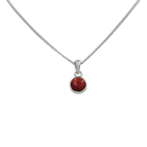 A simple round Coral pendant presented on a sterling Silver chain