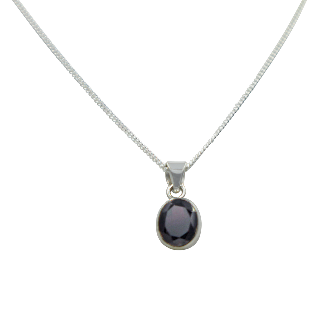 Cute oval faceted Garnet pendant set on a deep bezel setting