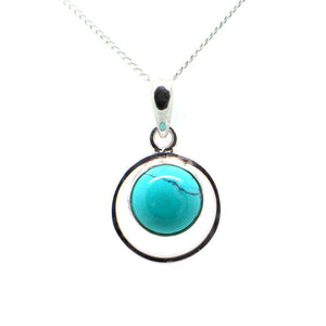 Round Sterling Silver Pendent with a Cbuchone Turquoise