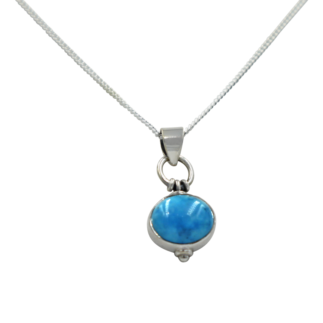 Oval Shaped simple but elegant pendant with a cabochon Turquoise stone
