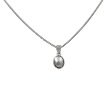 Load image into Gallery viewer, Slight oval simple fresh water Pearl set on a thin bezel setting