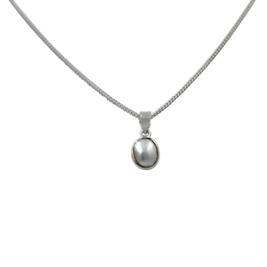 Slight oval simple fresh water Pearl set on a thin bezel setting