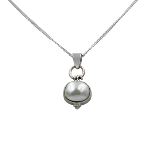Oval Shaped simple but elegant pendant with a cabochon Pearl