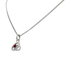 Load image into Gallery viewer, Celtic pendant with a half sphere faceted Ruby