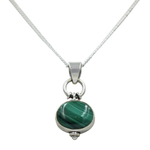 Oval Shaped simple but elegant pendant with a cabochon Malachite stone