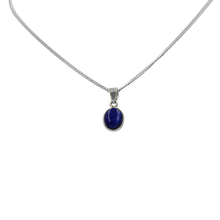 Load image into Gallery viewer, Slight oval simple cabochon Lapis Lazuli stone set on a thin bezel setting