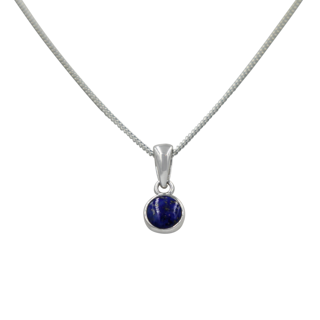 A simple round Lapis Lazuli pendant presented on a sterling Silver chain