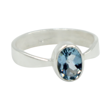 Load image into Gallery viewer, A very delicate ring in sterling silver with a small faceted oval Blue Topaz stone.
