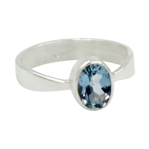 A very delicate ring in sterling silver with a small faceted oval Blue Topaz stone.