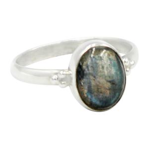 A simple and slightly ethnic ring with a large oval Dark Labradorite which can be used for everyday wearing