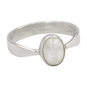A very delicate ring in sterling silver with two slight curves  in the shank and a small oval Rainbow Moonstone
