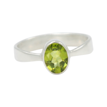 Load image into Gallery viewer, A very delicate ring in sterling silver with a small faceted oval Peridot stone.