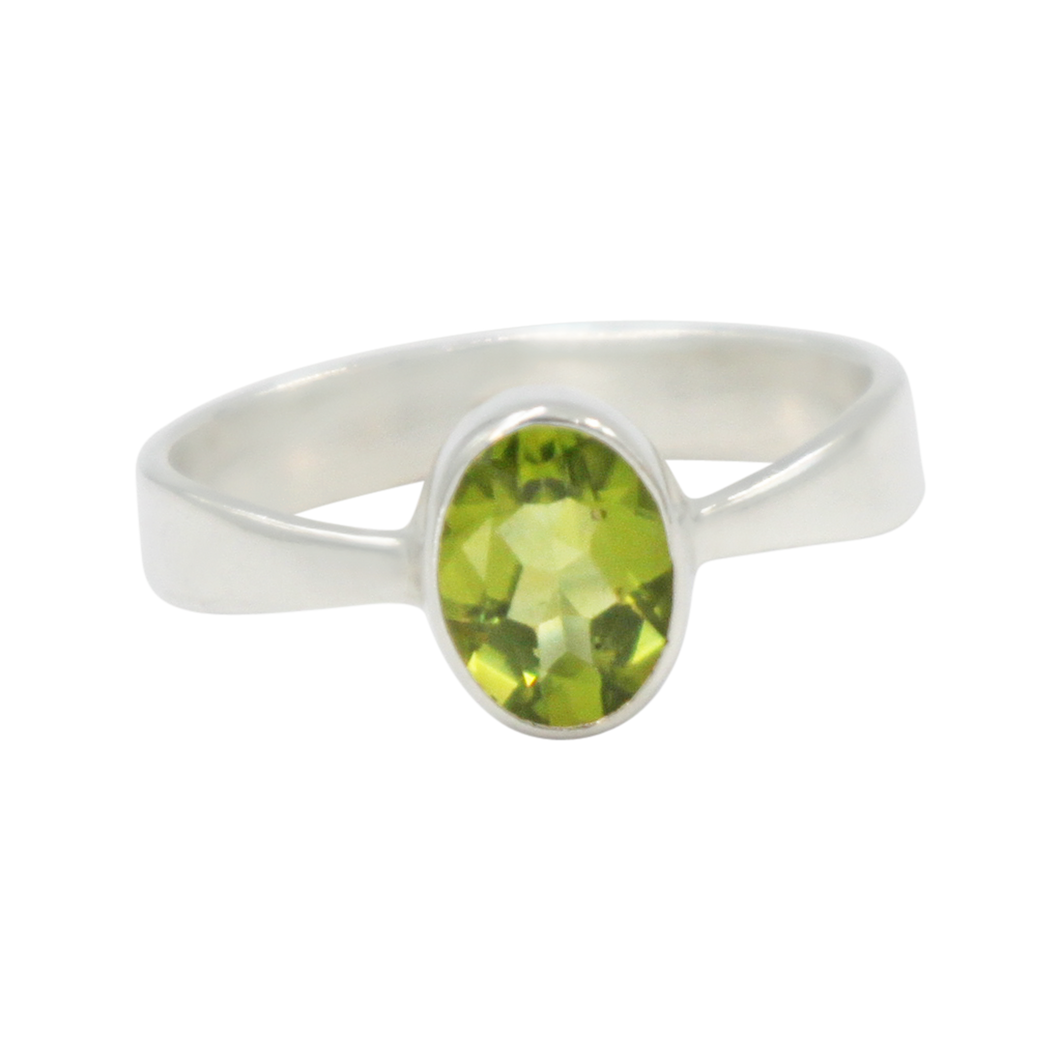 A very delicate ring in sterling silver with a small faceted oval Peridot stone.