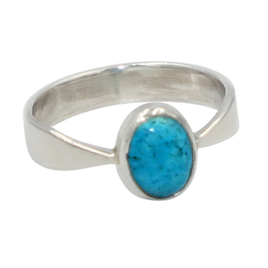 A very delicate ring in sterling silver with two slight curves in the shank and a small oval cabochon stone.