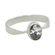 Load image into Gallery viewer, A very delicate ring in sterling silver with a small faceted oval Cubic Zirconia stone.