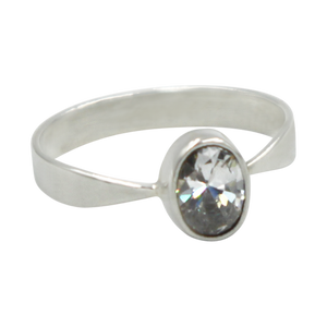A very delicate ring in sterling silver with a small faceted oval Cubic Zirconia stone.