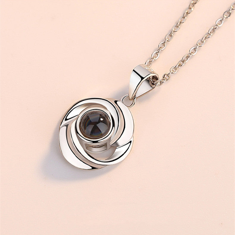 Memory Rotating Rose Necklace