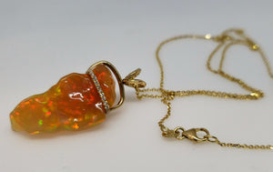 Carved orange opal spinning pendant #101