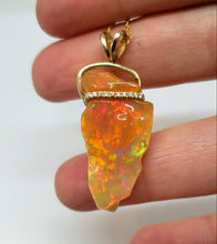 Load image into Gallery viewer, Carved orange opal spinning pendant #101