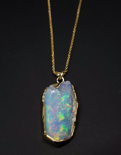 Carved Opal Gold Pendant