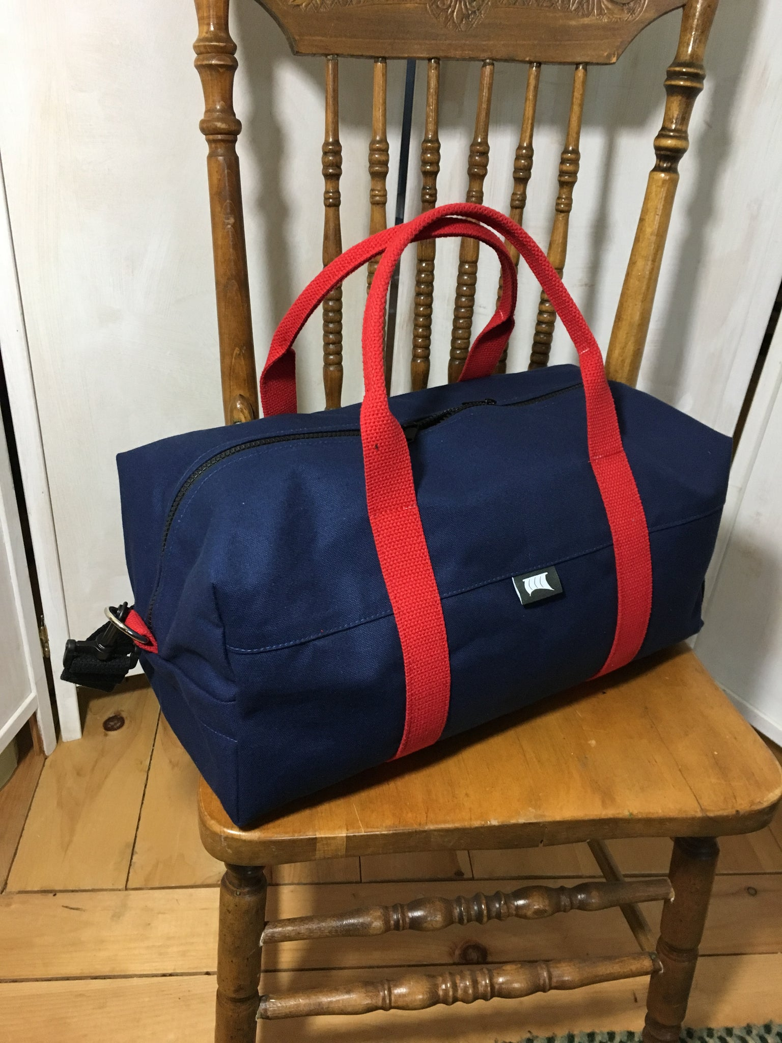 The Duffel (S) Navy/red *Available Now*