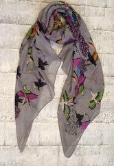 Grey scarf with brightly coloured birds