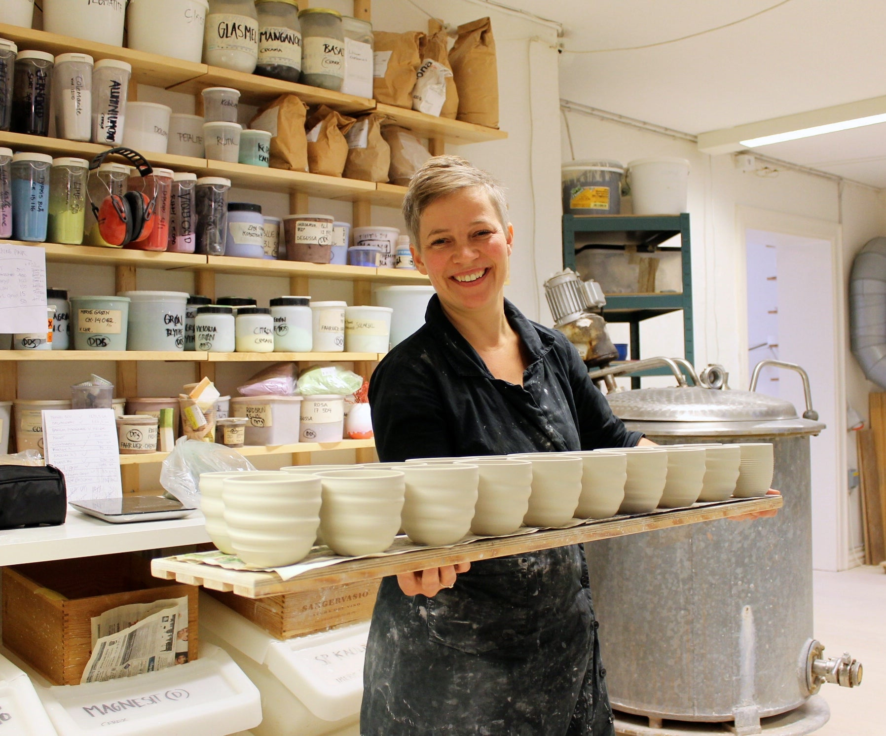 Sussi Krull stands with handmade Songlines cups in the ceramics shop on Willemoesgade 13.