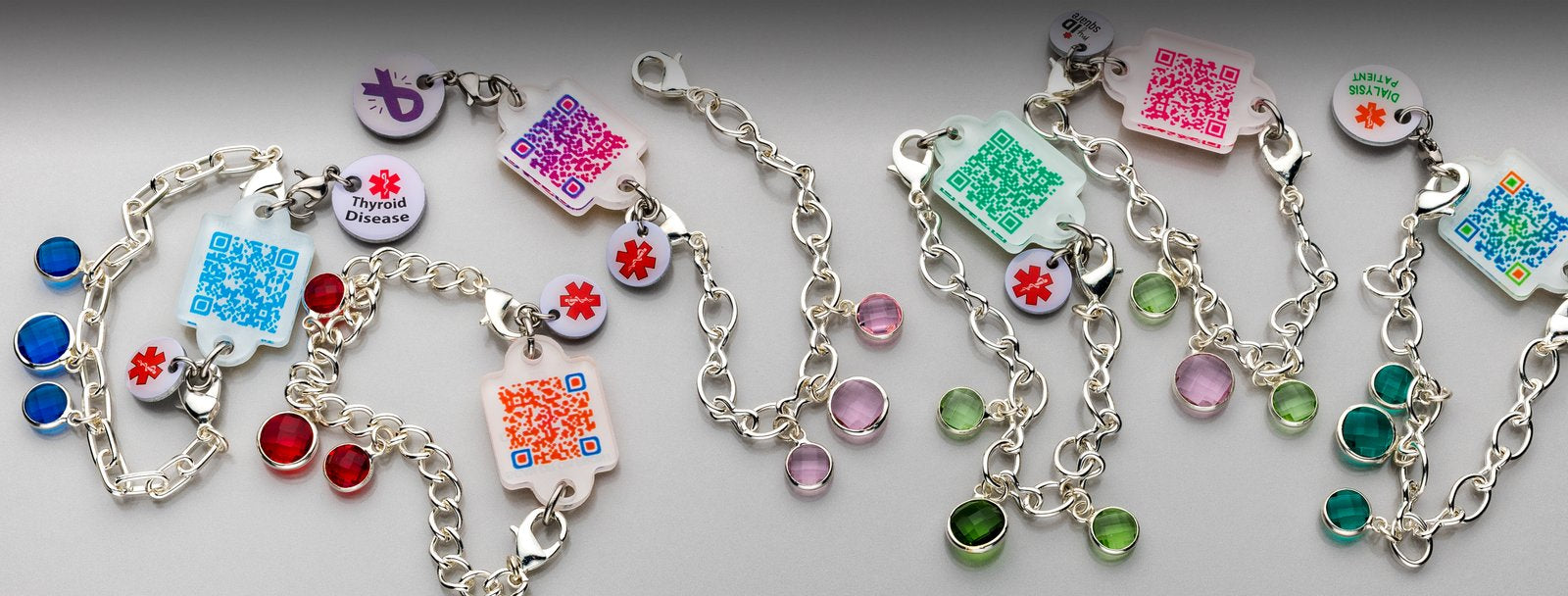 Colorful, interchangeable bracelet and necklace charms connect to your online medical information when the bar code is scanned or the URL on the back is accessed.