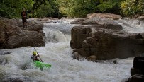 Slim river at normal flow. // Kayaker Flo Hafner