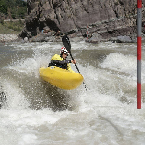 Level Six whitewater kayaking slalom action shot of athlete paddling