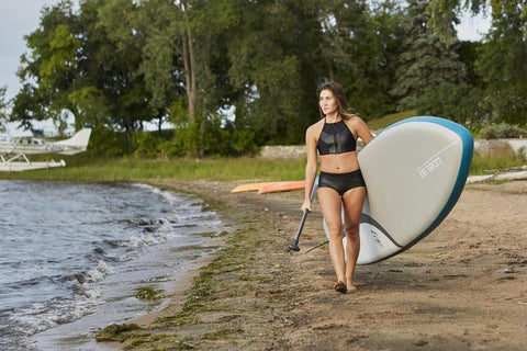 Level Six SUP board & stand up paddle boarding with women's neoprene swimwear