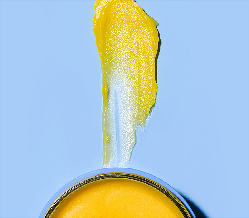 Texture shot of yellow cleansing balm