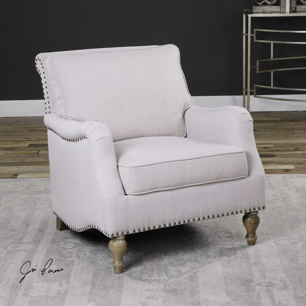 White English-style armchair with loose cushions and antique brass nailhead trim