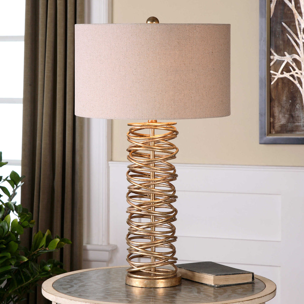 Layered metal ring lamp base finished in an antique silver champagne finish