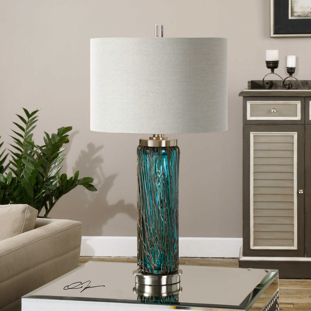 Blue glass base lamp with brushed nickel accents