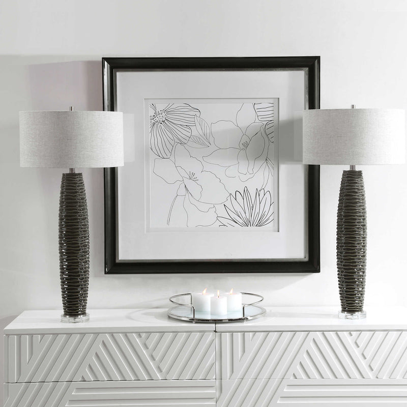 flanked charcoal gray table lamps on white console table