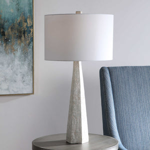 Off white, light gray and taupe toned concrete-look lamp along with brushed nickel accents