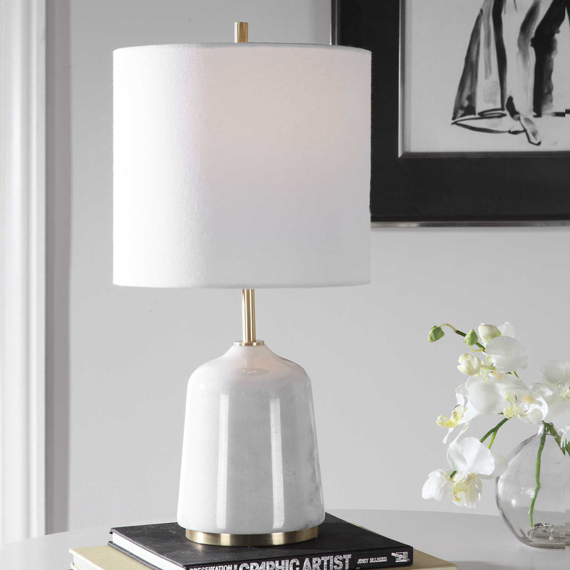 White buffet lamp on table with flower