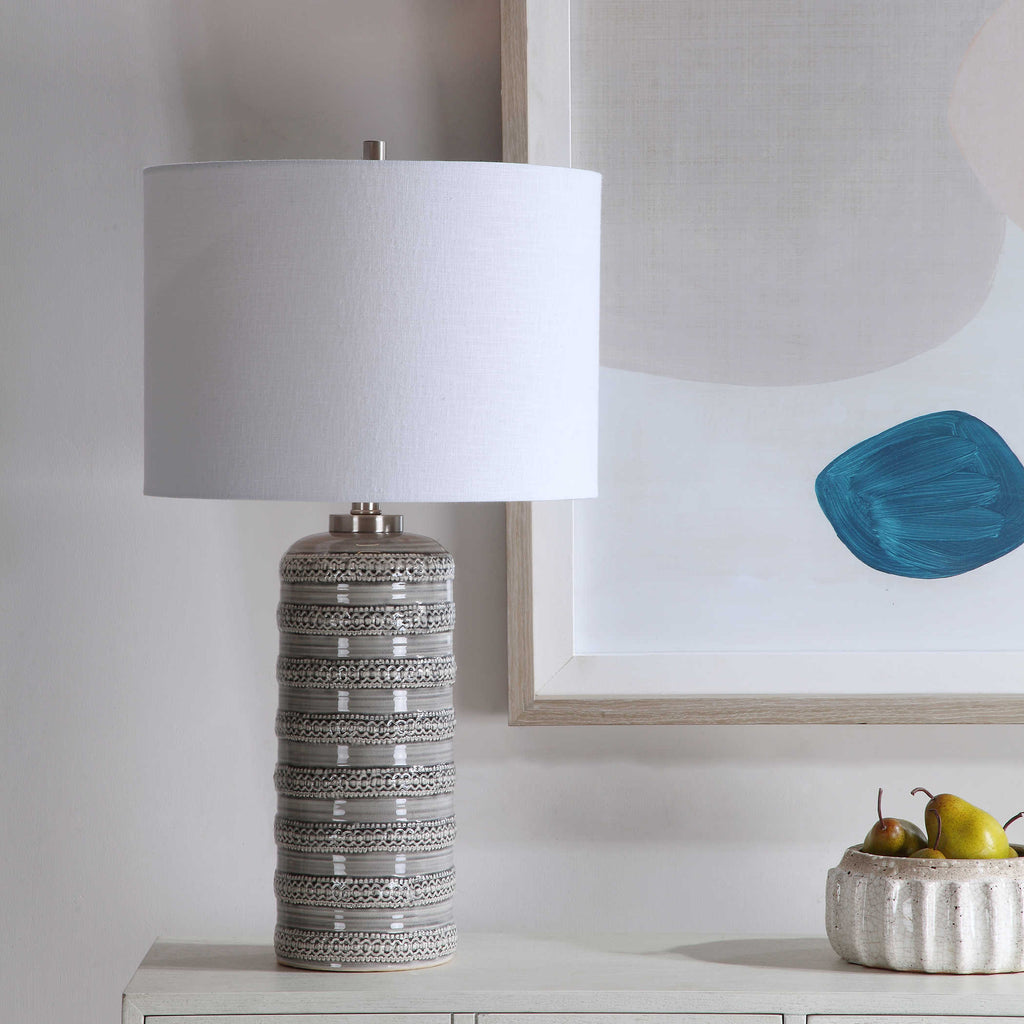 Gray glazed ceramic lamp base with an lace overlay design and brushed nickel details