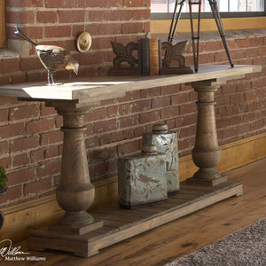 barnwood farmhouse distressed console table against brick wall