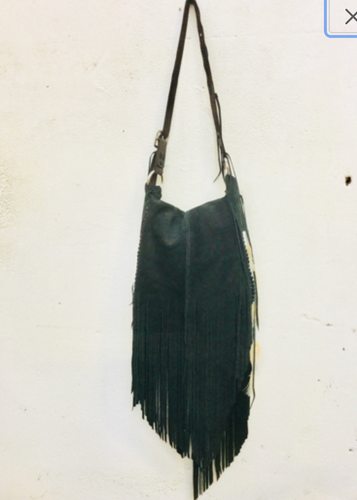 Cowhide Leather Bag with Tassels and Feathers.