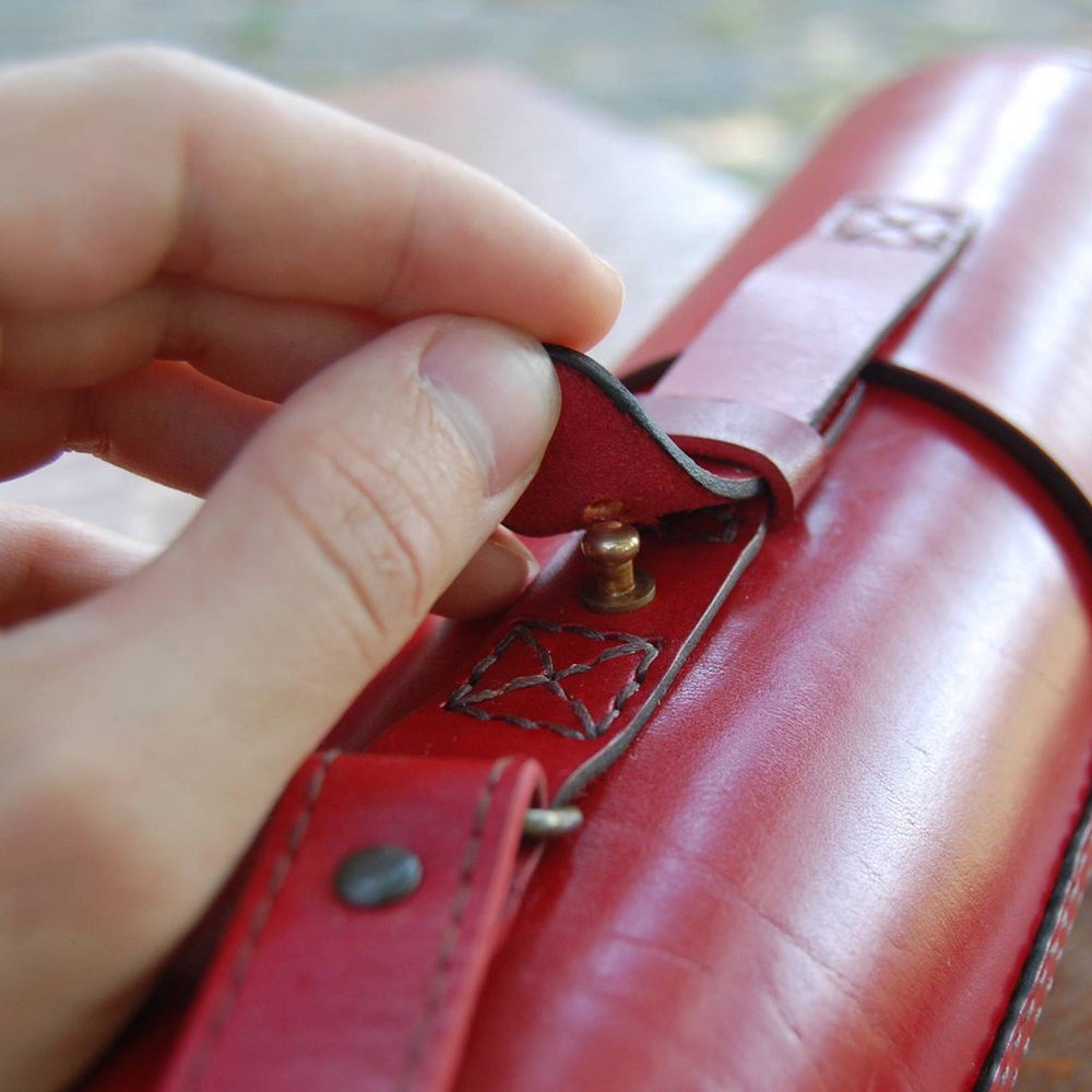 red blueprint tube leather gift