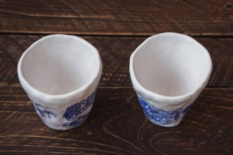 white blue set of coffee mugs