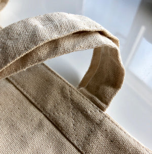 Let's Go Explore canvas tote stitching detail