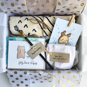 Curated care package with cute, inspirational gifts from Ao (pencil, collectible cards, tote, notes)