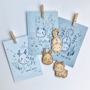 Wooden sprite Mimomori Cards Sprout, Fern, and Tree Sprite trinkets on collectible cards