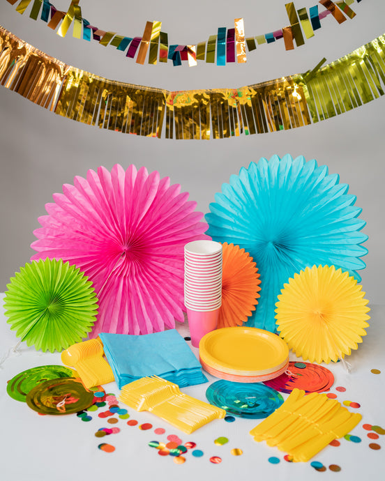 colorful summer party supplies, paper cups, paper plates, plastic forks/spoons/knives, party confetti, hanging decorations for a party