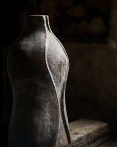 Curved rustic old vase