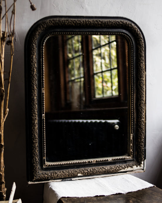 Antique French black and gold mirror